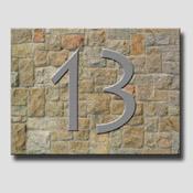 Numéro de porte fond pierres